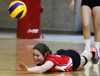 Cochrane Jaguars 17/U18 player Grace Chrisp is all smiles as she attempts to dig the ball out during the Provincial's in Calgary this past weekend.