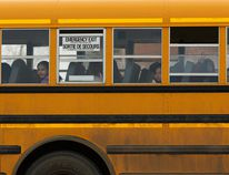 Kids wave as they ride the school bus in Fort McMurray on Thursday, April 6, 2017. Ian Kucerak / Postmedia