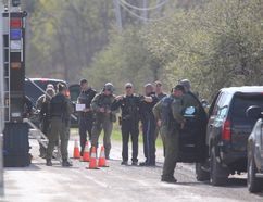 Police descended on Walker Road in Oneida Nation, Ont. in search of a man with a hand gun suspected of assault and taking a hostage on Wednesday. (Mike Hensen/The London Free Press)