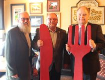 Richard Rainville, left, executive director of Reseau ACCESS Network, Greater Sudbury Mayor Brian Bigger and Kevin McCormick, president and vice-chancellor of Huntington University, and president of the Reseau ACCESS Network board of directors, all share a meal at Fionn MacCool's on Regent Street in support of the annual A Taste For Life fundraiser on Wednesday. Supplied photo