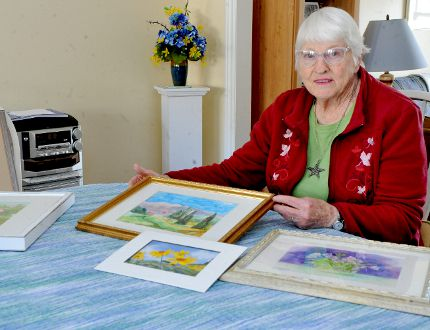 Margot Hamblen, a participant in this weekend's South Grenville Guild of Fine Art show, poses with some of her work on Wednesday in Brockville. (RONALD ZAJAC/The Recorder and Times)