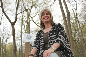 Bright's Grove artist Mary Abma is pictured here along what she's calling the Ash Tree Memorial Trail in Canatara Park. Abma will holding a memorial service and trail tour Saturday as part of a four-year-long art project to commemorate Canatara's fallen ash trees. (Barbara Simpson/Sarnia Observer/Postmedia Network)