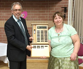 Judith Hennessey receives her Ongwanada Volunteer of the Year award from Wade Durling, chief executive officer of Ongwanada, at the organization's annual volunteer awards night on Wednesday. (Submitted Photo)