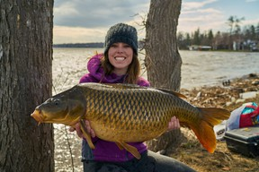 Columnist Ashley Rae with a personal-best carp, weighing 32 pounds, she caught on Lake Ontario. (Supplied photo)