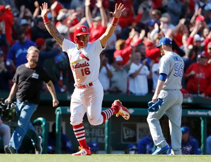 St. Louis Cardinals' Kolten Wong jogs in to score as Toronto Blue Jays relief pitcher J.P. Howell walks off the field following a walk-off grand slam by Matt Carpenter in the 11th inning on April 27, 2017, in St. Louis. (AP Photo/Jeff Roberson)