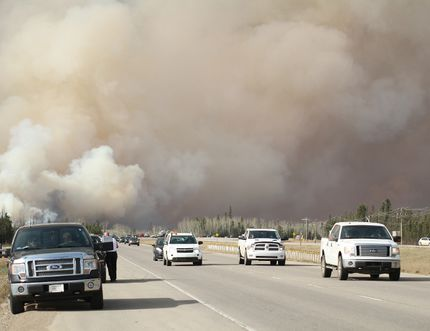 Residents of Fort McMurray flee wildfires while traveling south on Highway 63 in Fort McMurray Alta. on Tuesday May 3, 2016. Robert Murray/Fort McMurray Today/Postmedia Network