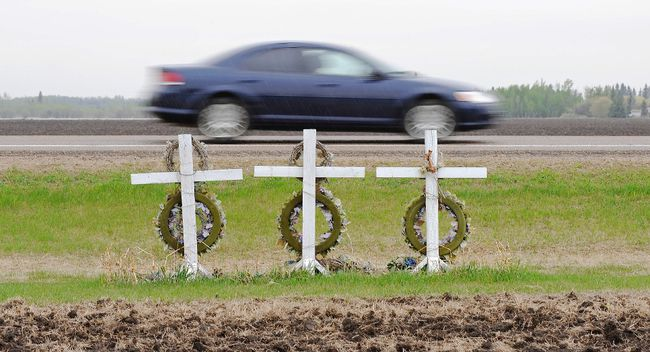 A memorial for three local victims killed along highway 63, just outside the town of Grassland, Alta., on May 16, 2012. Ed Kaiser/Postmedia