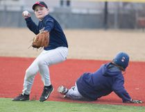 Ryan Rice of the Pee Wee AAA Oil Giants, left, turns to complete a double play during practice at Ross Hennigar Park Wednesday. The developmental season begins this weekend for the team. Robert Murray/Fort McMurray Today/Postmedia Network