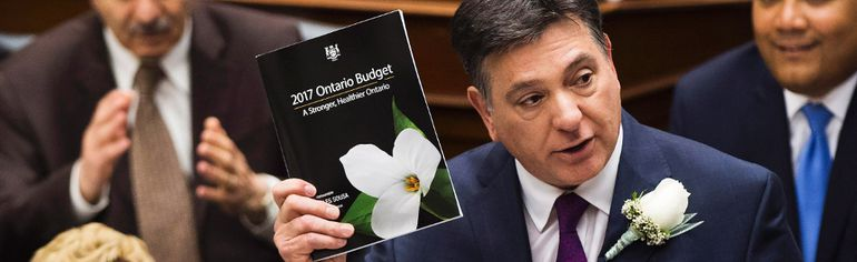 Ontario Finance Minister Charles Sousa, right, delivers the 2017 Ontario budget next to Premier Kathleen Wynne at Queen's Park in Toronto on Thursday. Nathan Denette/THE CANADIAN PRESS