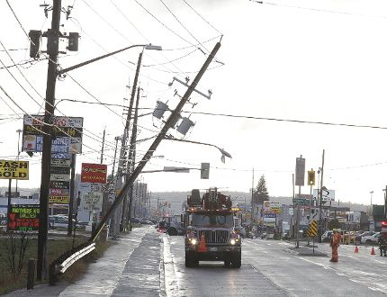 Greater Sudbury Utilities crews were on the scene at Lasalle Boulevard where a hydro pole was hanging precariously over the road in Sudbury, Ont. on Thursday April 27, 2017. The road was closed while crews worked to fix the problem.Thursday afternoon's downburst levelled many trees and shingles in the Greater Sudbury area. Gino Donato/Sudbury Star/Postmedia Network