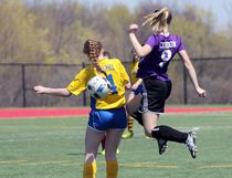 Huron Park Secondary School's Emily Cordon, right, and College Avenue Secondary School's Lauryn McGhee leaps for control of the ball in their game in London, Ont. at City Wide Fields on Monday April 24, 2017. Huron Park won 5-2 to open the girls' soccer season. Greg Colgan/Woodstock Sentinel-Review/Postmedia Network