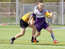 Huron Park Secondary School's Caleb Wells, right, slips past a tackle attempt by a Glendale Gemini in their TVRA 'A/AA' rugby game in London, Ont. on Wednesday April 26, 2017 at Western University's alumni field. Huron Park won 17-0. Greg Colgan/Woodstock Sentinel-Review/Postmedia Network