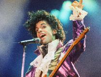 "In this Feb. 18, 1985 file photo, Prince performs at the Forum in Inglewood, Calif. A pair of record labels announced Friday, April 28, 2017, that a remastered edition of Prince's landmark 1984 album ""Purple Rain"" will be released on June 23, 2017. The labels say Prince oversaw the remastering process in 2015 and the ""Purple Rain Deluxe"" will include six previously unreleased songs by the late singer-songwriter, who died one year ago. (AP Photo/Liu Heung Shing, File)"