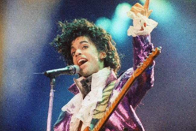 """In this Feb. 18, 1985 file photo, Prince performs at the Forum in Inglewood, Calif. A pair of record labels announced Friday, April 28, 2017, that a remastered edition of Prince's landmark 1984 album """"Purple Rain"""" will be released on June 23, 2017. The labels say Prince oversaw the remastering process in 2015 and the """"Purple Rain Deluxe"""" will include six previously unreleased songs by the late singer-songwriter, who died one year ago. (AP Photo/Liu Heung Shing, File)"""