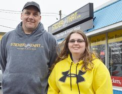 Alexis Van Dolder and her father Ed stand outside their Sticker That storefront on Grand Avenue East in Chatham. Alexis started the business as a summer project in 2013 and is currently preparing to open a second location on St. Clair Road. Louis Pin/Postmedia Network