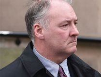 In this Tuesday Feb. 21, 2017 file photo, former breast surgeon Ian Paterson arrives at Nottingham Crown Court in Nottingham, England. A jury in central England has found a prominent breast surgeon guilty of carrying out unnecessary operations. The Nottingham Crown Court jury found Ian Paterson guilty on Friday, April 28 of 17 counts of wounding with intent to cause grievous bodily harm and three counts of unlawful wounding. Prosecutors say the 59-year-old doctor lied to patients or exaggerated their risk of cancer to persuade them to have surgery. (Joe Giddens/PA via AP, file)