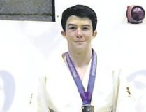Canmore's Mckenize Morgan on the podium after receiving his silver medal in the junior men's under-81 kilograms division at the Sportif International Judo Tournament in Edinburgh, Scotland on April 15, 2017.