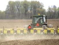 """Dave Donaldson plants corn north of London. Compared to last year's extremely early start, Donaldson said this year's planting time is """"middle of the road."""" (MIKE HENSEN, The London Free Press)"""
