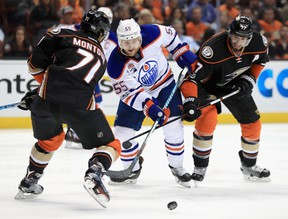Brandon Montour #71 and Ryan Kesler #17 of the Anaheim Ducks defend against Mark Letestu #55 of the Edmonton Oilers in the second period in Game One of the Western Conference Second Round during the 2017  NHL Stanley Cup Playoffs at Honda Center on April 26, 2017 in Anaheim, California.