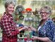 Susan Coventry (left) talks about collectibles with vendor Janet Blake.