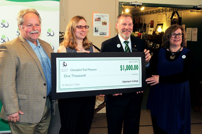 Sean Chase/Daily Observer Algonquin College's Pembroke Campus kicked off their 50th anniversary Thursday with a $1,000 donation to the Champlain Trail Museum and Pioneer Village. In the photo are (left to right) Phil Corriveau, chairman of the museum committee, museum curator Angela Siebarth, Algonquin vice-president of academics Claude Brule and Pembroke Campus dean Karen Davies.