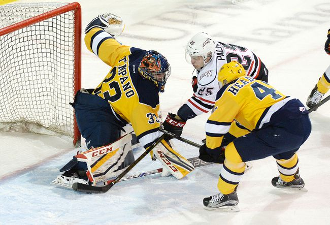 ERIE, PA. - Erie Otters goaltender Troy Timpano (left) makes a save on Owen Sound Attack forward Petrus Palmu (centre) in Game 5 of the OHL Western Conference Finals on Friday. Photo by Jack Hanrahan (ETN)