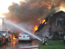 Municipality of Kincardine firefighters are seen battling a house fire and vehicles in the driveway at 756 Reynolds Drive on Friday, April 28, 2017. (Ryan Berry/Kincardine News and Lucknow Sentinel)