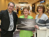 Tim Thomson, media sales consultant with The Sudbury Star, and Brenda Folz, right, marketing director of the New Sudbury Centre, presented Phyllis Skiffington with gift cards at the shopping centre in Sudbury, Ont. Skiffington is the grand prize winner in The Star's annual ice guessing contest. John Lappa/Sudbury Star/Postmedia Network
