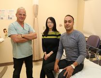 Toronto health professionals Dr. Chris Boulias, left, occupational therapist Ayako Sasaki and Dr. Farooq Ismail held clinics at Health Sciences North in Sudbury, Ont. this past weekend to provide patients post-stroke treatment and management. John Lappa/Sudbury Star/Postmedia Network