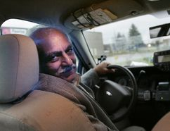 London taxi driver Vijay Bhatia, 64, was killed early Saturday when he was attacked by a passenger in the parking lot of a convenience store in south London. A 23-year-old London man is charged with second-degree murder in the death of Bhatia, shown in this file photo.