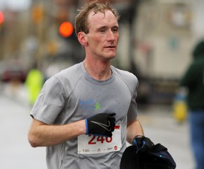 Rob Asselstine of Sydenham places first in the KRRA Limestone Race Weekend half marathon in Kingston, Ont. with a time of 1:11:59 on Sunday April 30, 2017. Steph Crosier/Kingston Whig-Standard/Postmedia Network