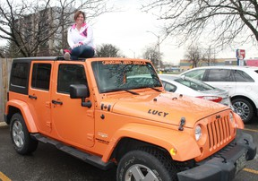 Sarnia's Natasha Kokkinis (sitting atop her jeep 'Lucy') is compiling stories, photos, videos and anecdotes of Jeepers around the world for her multimedia project, The Faces of Jeep.  CARL HNATYSHYN/SARNIA THIS WEEK
