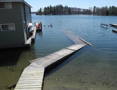 A dock is shown under water on Bayview Road in Brockville in April. (FILE PHOTO)