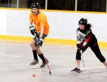 Kris Koskela of team Whitney Fire Department tries to elude Sabrina Boucher of the Gatrem Foxes in Adult Co-Ed 'B' division play as the 2017 spring season is officially underway at Game On Timmins Ball Hockey. BENJAMIN AUBÉ/THE DAILY PRESS