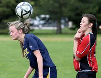 Pain Court Patriotes' Sydney McArthur, left, heads the ball away from Lambton-Kent Cardinals' Kelsea Ellis in the second half of an LKSSAA senior girls soccer game Monday, May 1, 2017, at Ecole Secondaire de Pain Court. (MARK MALONE/The Daily News)