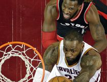 Cleveland Cavaliers' LeBron James drives to the basket against Toronto Raptors' DeMarre Carroll in the first half in Game 1 of a second-round NBA basketball playoff series, Monday, May 1, 2017, in Cleveland. The Cavaliers won 116-105. (AP Photo/Tony Dejak) ORG XMIT: OHTD121