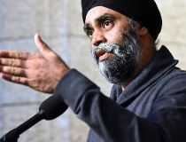 Minister of National Defence Harjit Sajjan speaks to reporters during a weekend meeting of the national caucus on Parliament Hill in Ottawa on Saturday, March 25, 2017. THE CANADIAN PRESS/Justin Tang