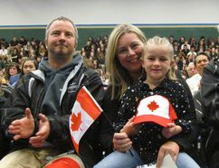 From left, Andrew Kraft, 10, Matt Kraft, Marina Kraft and Piper Kraft, 8, were in the front row of a citizenship ceremony held Wednesday May 3, 2017 in the gym at St. Patrick's Catholic High school in Sarnia, Ont. The Kraft family of Port Franks were there to watch as Marina, who was born in Holland, took her oath of citizenship. (Paul Morden/Sarnia Observer)