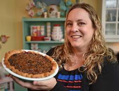 Karlynn Johnston, author of the cookbook Flapper Pie and Blue Prairie Sky, holds a Saskatoon Butter Tart Pie in Edmonton on Oct. 14, 2016. (Ed Kaiser/Postmedia Network)