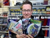 "Gord Mood, co-owner of LA Mood, says his store plans to give away ""at least 3,000"" comics. (MORRIS LAMONT, The London Free Press)"