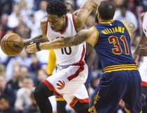 Raptors' DeMar DeRozan (left) drives past Cavaliers' Deron Williams during first half NBA playoff action in Game 3 of the Eastern Conference Semifinals at the Air Canada Centre in Toronto on Friday, May 5, 2017. (Ernest Doroszuk/Toronto Sun)