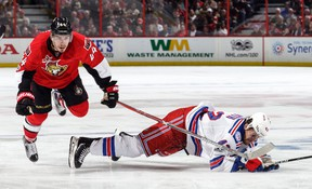 Jean-Gabriel Pageau of the Ottawa Senators trips over a falling Brendan Smith of the New York Rangers during Game 5 of the Eastern Conference semifinal at the Canadian Tire Centre on May 6, 2017 in Ottawa. (Jana Chytilova/Freestyle Photography/Getty Images)