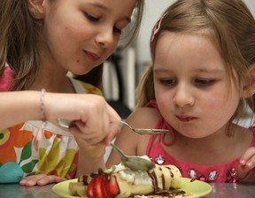 FILE PHOTO: Darcy Radies is a chef at the Blue Pear and he's going to prepare a brunch suitable for children and dads to make for moms on Mother's Day. The children are Mason, 6, and Tayler, 4. Mom is Jessie.