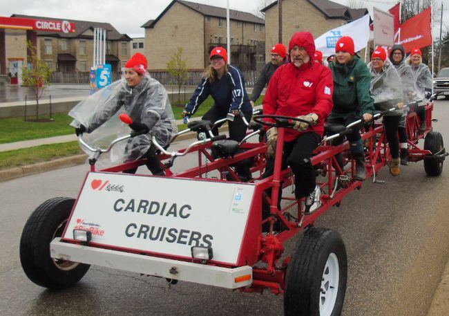 Members of the Cardiac Cruisers Big Bike team from Saugeen Shores Family Eye Care braved cold rainy weather May 5 to raise approximately $1,600 in pledges and donations in the annual Heart & Stroke Foundation's annual Big Bike event in Port Elgin. Three teams of riders generated approximately $4,100 from riders who paid $50 and collected pledges to hop on the 30-seat bike. Frances Learment/Shoreline Beacon
