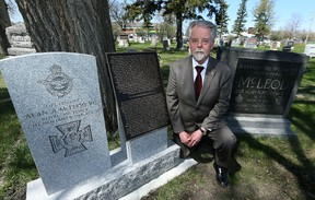 Irwin Kumka from the Historic Kildonan Church and Cemetery Inc., poses next to a new gravestone and memorial to honour the life of Lt. Alan Arnett McLeod V.C. on Sun., May 7, 2017. A commemoration will take place at McLeod's grave site on Tuesday. Kevin King/Winnipeg Sun/Postmedia Network