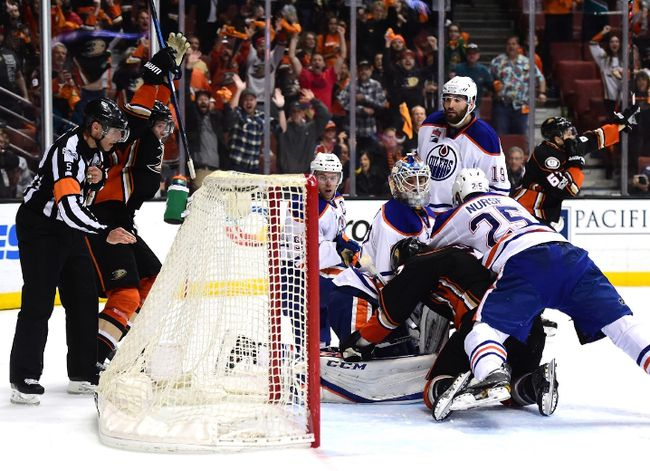 Oilers goalie Cam Talbot gets piled on as the Ducks scored with fifteen seconds left to tie the score in Game 5. (Getty Images)