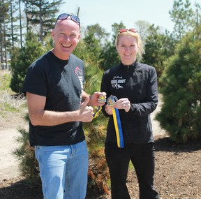 Wes Harding and his sister Chantelle Peters show off the medals they received after competing in the 2017 Boston Marathon on April 17. CARL HNATYSHYN/SARNIA THIS WEEK