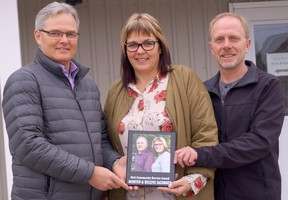 Lucknow Chamber of Commerce president Keith Raymond recently presented the chamber's Community Service Award to Helene and Morten Jakobsen.