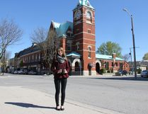 Lindsay Kernohan, museum curator, stands with her camera in front of the Clock Tower, one of the town's most iconic buildings. She is leading a project that aims to create a record of the municipality in 2017 through images taken by members of the community. JONATHAN JUHA/STRATHROY AGE DISPATCH/POSTMEDIA NETWORK