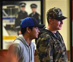 The city is expanding a program that offers free transit aimed at helping homeless individuals and those at high risk of homelessness like Trent Pierre (L) and Elias Thompson both 18, in Edmonton, May 9, 2017.